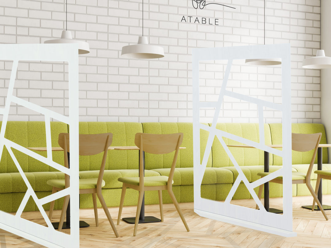 Corner of an industrial style cafe interior with white brick walls, a wooden floor, and wooden tables with chairs and green sofas. 3d rendering mock up